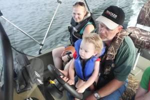Emma driving pawpaw's boat
